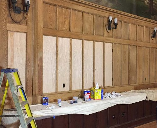 Replacement panels lighter than existing stripped woodwork.